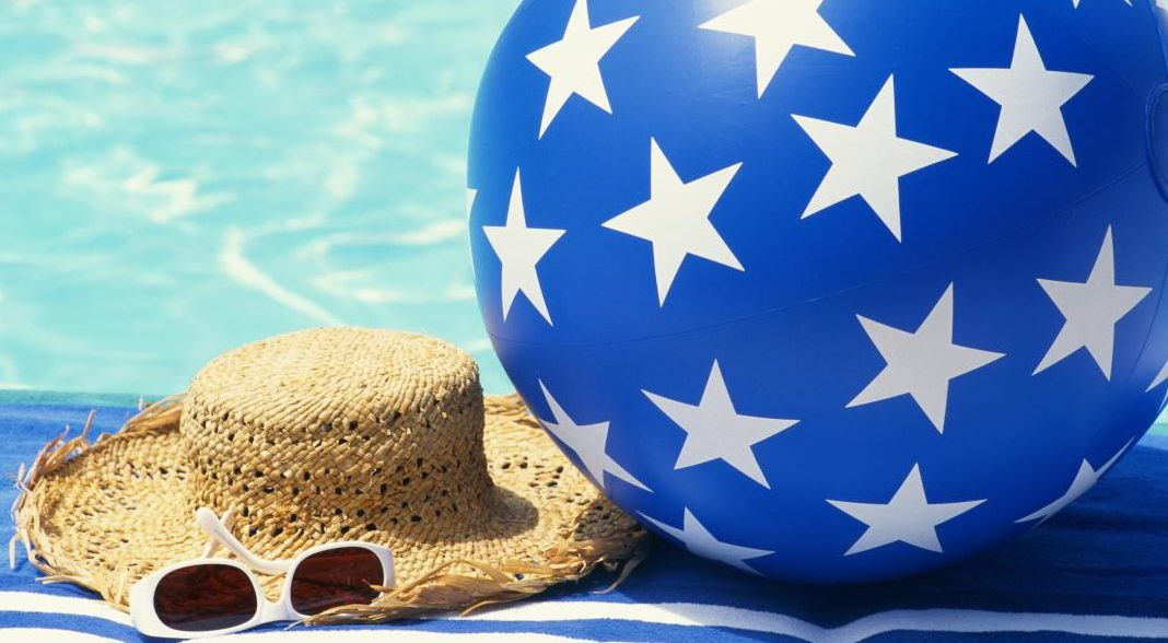 beach ball and hat by the pool