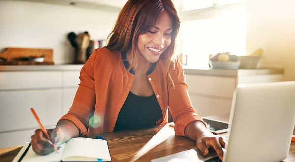 woman working on a laptop in her kitchen, Mortgage Loans baton rouge, home loans baton rouge
