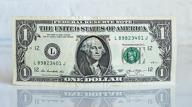 dollar bill on a white table