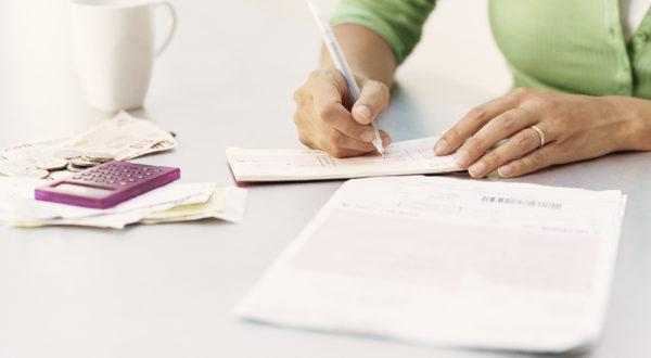 woman writing a check
