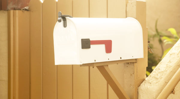 mailbox in front of a wood fence, freedom checking account, How to Switch