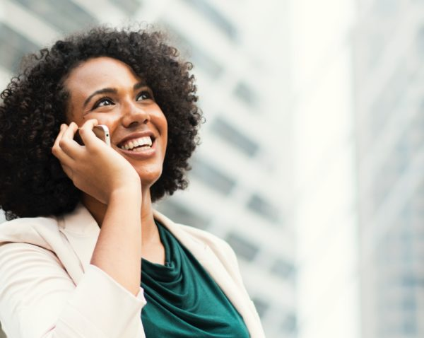 woman smiling talking on her cell phone