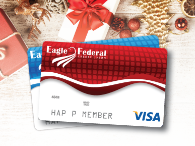 Eagle Federal debit and credit cards on wood floor with holiday decor