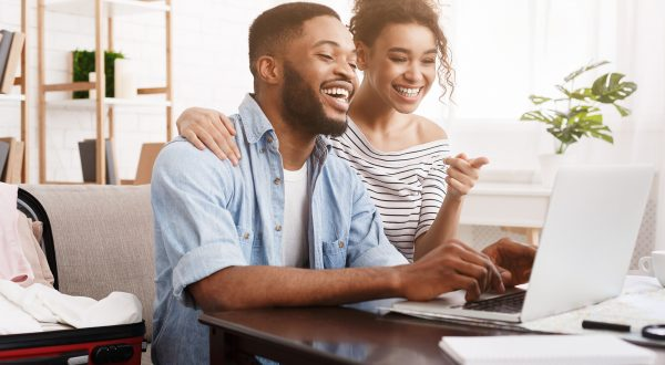 African-american couple using laptop,
